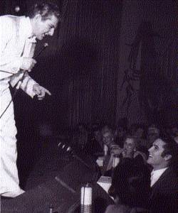 Liberace, recognizing a face in the crowd at the Riviera's Clover Room.