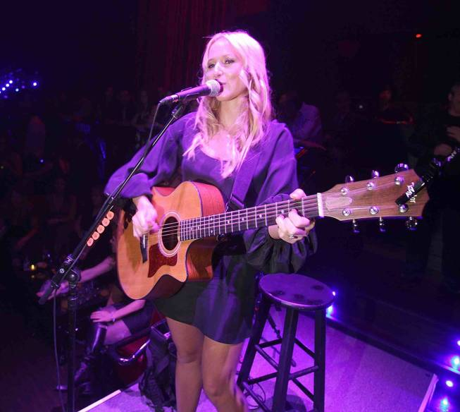 Jewel breaks out the acoustic guitar at LAX.