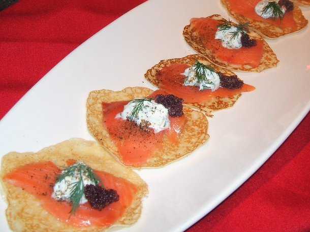 Savory mini-crepes with smoked salmon and dill sour cream by Firefly.