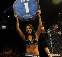 Ring girl Arianny Celeste signals the start of a fight.