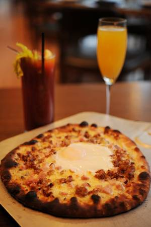 A breakfast pizza and a mimosa might be the perfect way to kick a morning hangover. If that doesn't work, the host stand at Simon is stocked with Pepto and Tums.