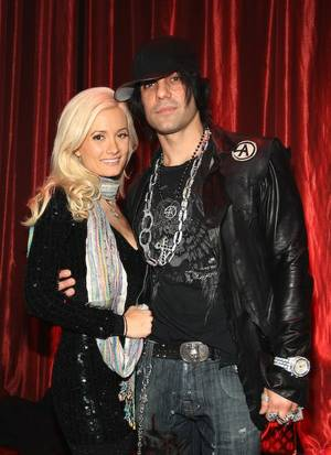 Holly Madison and Criss Angel.