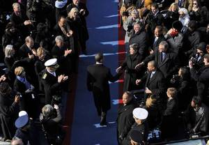 Barack Obama arrives for his inauguration at the U.S. Capitol in Washington.