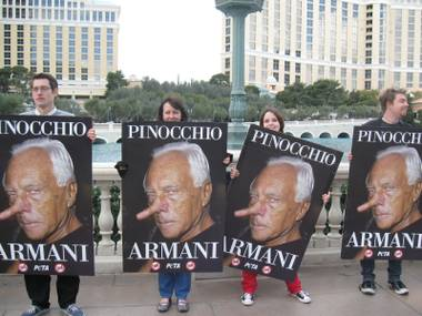 PETA protesters line the Strip on Monday, January 26 for a boycott of Armani's new fur-heavy collection.