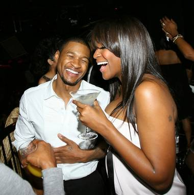 Usher and his wife, Tameka Foster, share a laugh.