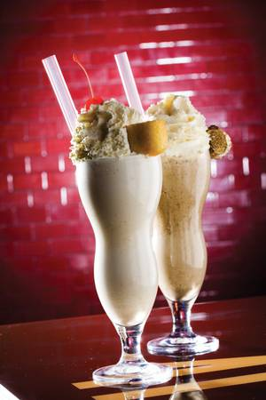 Spiked Milkshakes, an adult-only indulgence. Malibu Barbie is a creamy coconut concoction and Night Rider is a potent parfait of Kahlua, Oreo cookies and chocolate ice cream.