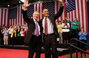 Senate Majority Leader Harry Reid, left, (D-Nev.) and President Barack Obama wave as they conclude a town hall meeting at Green Valley High School in Henderson Friday, February 19, 2010.