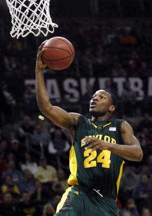 Baylor's LaceDarius Dunn (24) goes for the basket against Kansas in the second half during an NCAA college basketball game at the Big 12 Conference men's tournament in Oklahoma City, Thursday, March 12, 2009.