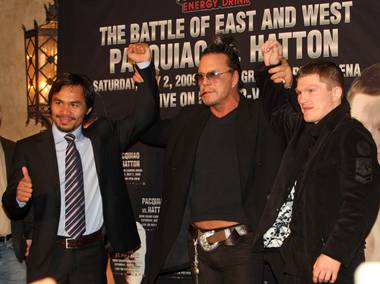 Boxers Manny Pacquiao, left, of Philippines and Ricky Hatton, right, of England pose with actor Mickey Rourke during a news conference in Hollywood, California March 30, 2009. Hatton and Pacquiao will meet for a junior welterweight (140 lbs) bout at the MGM Grand Garden Arena in Las Vegas on May 2.