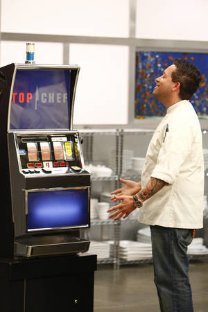 Michael I. consults the Quickfire slot machine for his three words to cook by on <em>Top Chef: Las Vegas</em>.