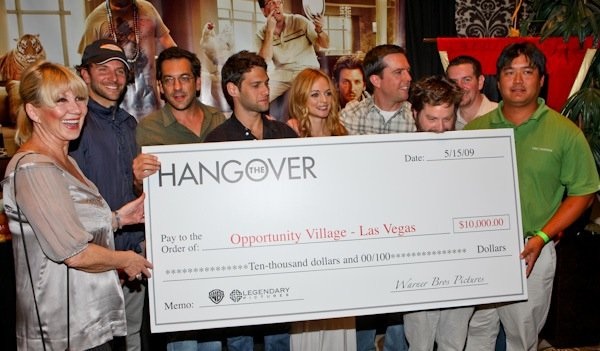 The Hangover cast with their check to Opportunity Village.