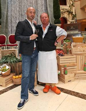 Joe Bastianich and chef Mario Batali at Mario Batali's farmers market Bet on the Farm in the Palazzo.