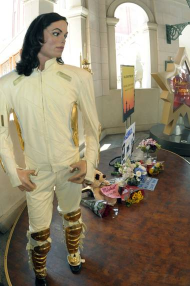 A wax figure and tribute to Michael Jackson stand in front of Madame Tussauds Las Vegas at The Venetian.