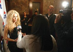 Shakira being interviewed on the red carpet.