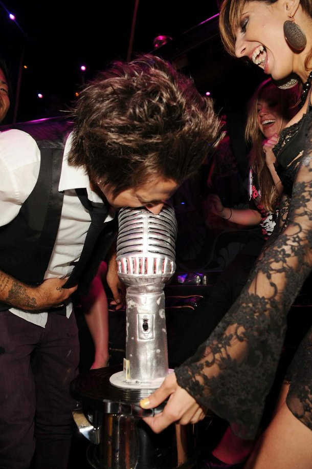 Ryan Cabrera gets a mouthful of microphone during his 27th birthday celebration at Prive.