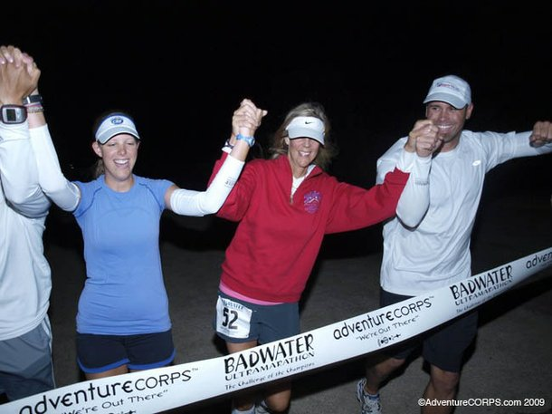 Molly Sheridan crosses the Badwater Ultramarathon finish line with her daughter and crew.