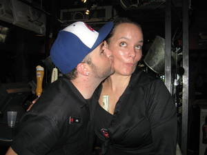 Bartender/GM Erin Connelly gets a smooch from a fellow unemployed bartender.