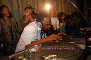DJ Spinna works the turntables with Stevie Wonder nearby at a past WONDER-Full event.