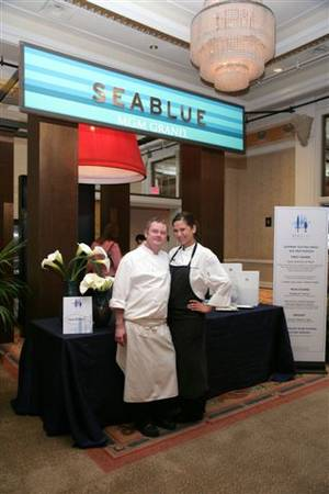 Stephen Hopcraft and Santanna Salas pause outside Seablue at the MGM Grand during shooting for Food Network show <em>Chefs vs. City</em>.