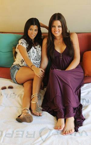 Kourtney Kardashian and Khloe Kardashian at MGM Grand's Wet Republic Ultra Pool.