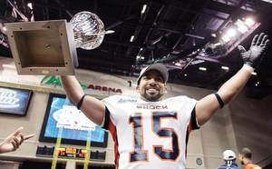 Raul Vijil of the Spokane Shock celebrates with the 2009 ArenaCup trophy after his team defeated the Wilkes-Barre/Scranton Pioneers Saturday, 74-27.