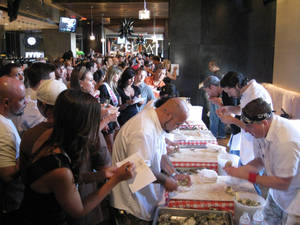 What would an oyster-eating competition be without restaurant industry employees yelling sexual innuendos at their fellow chefs?