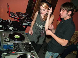 Deanna Rilling learns to spin on vinyl with instruction from Joe Garcia.
