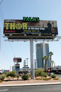 Thor on the billboard promotes <em>Thor at the Bus Stop</em>