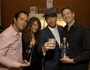 Pussycat Dolls creator Robin Antin and performer Matt Goss with Karma Tequila co-founders Devin Semler and Gary Eisenberger in the swag room at the Andre Agassi Foundation Grand Slam for Children.