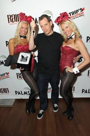 DJ Z-Trip is flanked by Playboy Bunnies Jessa and Denise at Rain in the Palms.