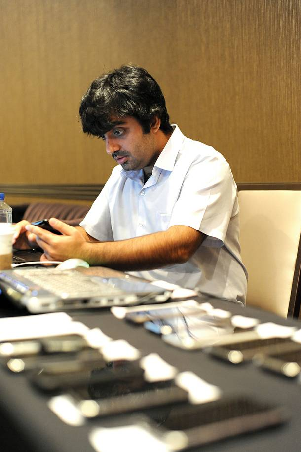 Mahipal Raythattha loads LoveSystems' pickup app into attendees' iPhones.
