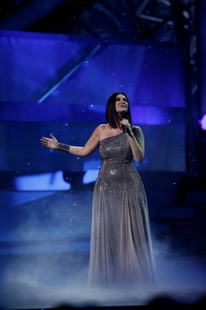 Laura Pausini opened the 10th Annual Latin Grammy Awards with a breathtaking performance backed by artists from Le Reve. She went on to win Best Female Pop Vocal Album.