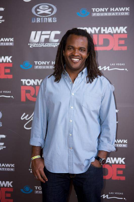 E! personality and former action sports commentator Sal Masakela smiles on the red carpet at Stand Up for Skateparks.
