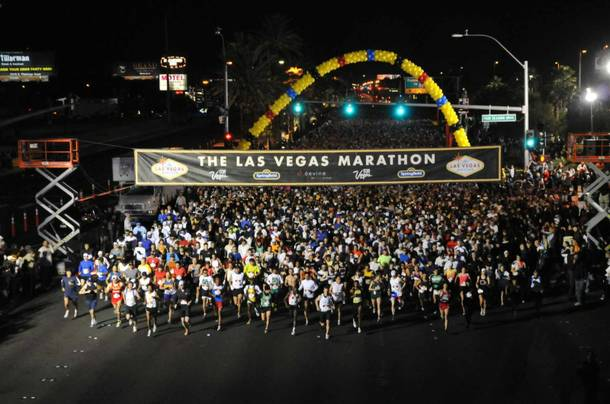 Crowds swarm the starting line of the Las Vegas Marathon.