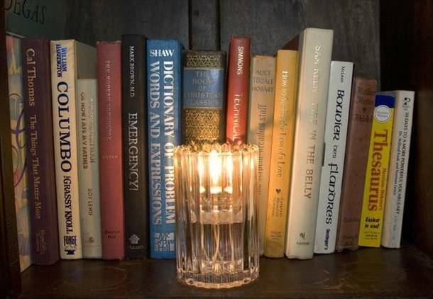 Lots of candles and books add to the living room feel of the Artisan Hotel lounge. The lounge has become a popular late-night hangout for entertainers and musicians who come to the bar after their shows.