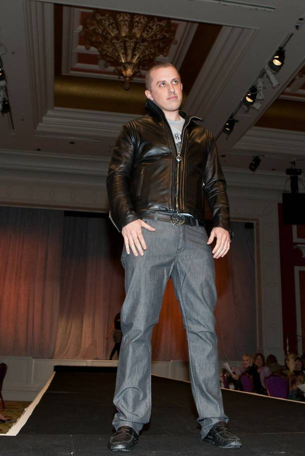 Tao Group entertainment marketeer Mike Snedegar struts down the catwalk in a King Baby leather jacket and shirt and slacks by John Varvatos.