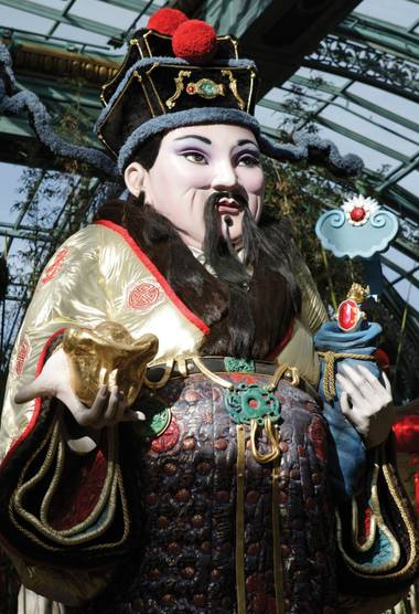 Lucky charm: A Chinese god of prosperity presides over the Bellagio Conservatory & Botanical Gardens.