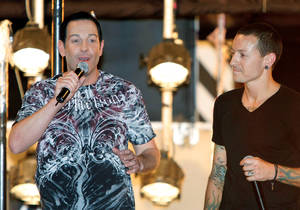 "Flaming out: Steve Wyrick (left) and Linkin Park singer Chester Bennington introduce the ""Death Drop"" stunt on July 4, 2009."