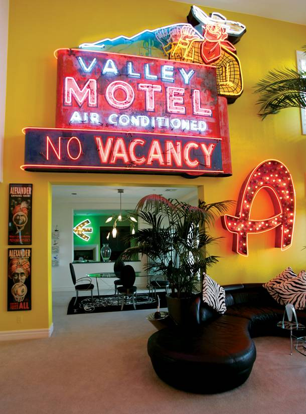 Wyrick's lavishly furnished home complete with neon signs and original art.