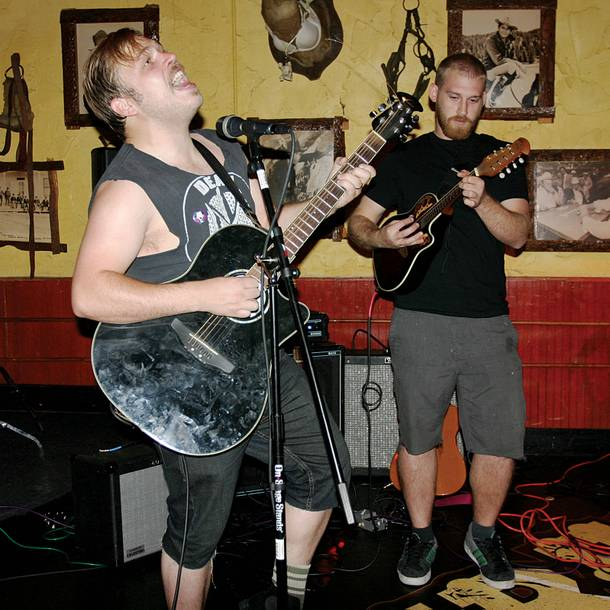Two-man band Holding on to Sound's Mains (left) and The Core's Frabbiele go acoustic.