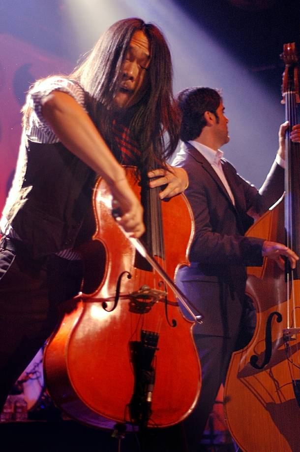 Joe Kwon performs with The Avett Brothers