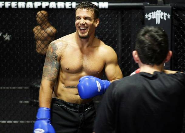 UFC heavyweight fighter Frank Mir laughs during a workout at his gym Friday, September 17, 2010. Mir will fight Mirko Cro Cop Filipovic in the main event of UFC 119 in Indianapolis.