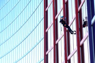 Laughing at gravity (and lunch) during a 400-foot rappel down the Rio.