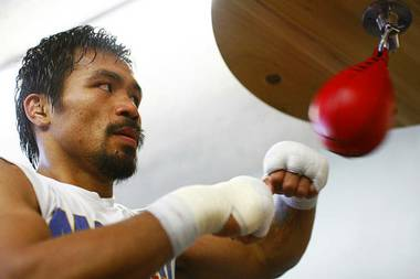 Manny Pacquiao hits a speedbag during a workout at Wildcard Boxing Club in Hollywood, Calif., on Nov. 8, 2010. Pacquiao takes on Antonio Margarito at Cowboys Stadium in Arlington, Texas, on Nov. 13.