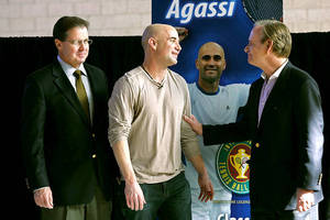 Andre Agassi talks with International Tennis Hall of Fame Chairman Christopher Couser, right, and CEO Mark Stenning after an announcement of Agassi's induction into the International Tennis Hall of Fame on Thursday, Jan. 20, 2011, at the Andre Agassi College Preparatory Academy. Agassi will be officially inducted July 9.