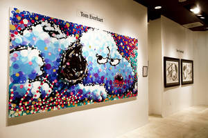"(Copyright Tom Everhart) The original museum piece ""Stalking in L.A."" (foreground) is on display at Jack Gallery, which exclusively produces fine art lithographs of Everhart's work. His most recent collection, <em>Scratch and Sniff</em> (background), captures the spirit of Charles Schulz and his beloved characters."