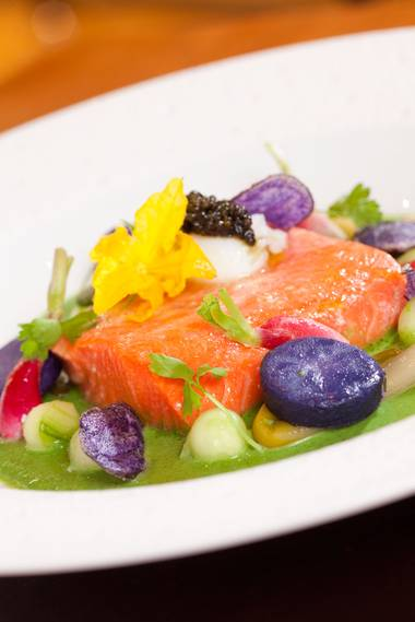 Ocean-water poached sockeye salmon with caviar and purple potatoes.