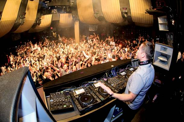 Resident DJ Kaskade packs Marquee nightclub with EDM fans.
