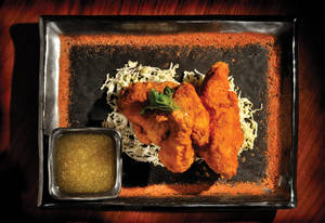 The fried chicken that launched 1,000 accolades, served with wasabi-honey dipping sauce.