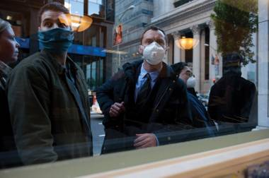 Do those tiny masks really keep you from getting sick? Jude Law finds out in 'Contagion.'